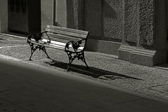 Vacant public bench in the street Stock Photos