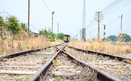 Vacant Rail way switch track with yellow die grass Royalty Free Stock Photos