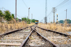 Vacant Rail way switch track with yellow die grass. Royalty Free Stock Photos
