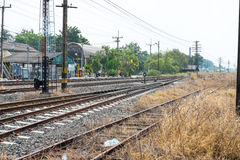 Vacant Rail way switch track with yellow die grass. Stock Photos
