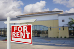 Vacant Retail Building with For Rent Real Estate Sign. In Front Stock Image