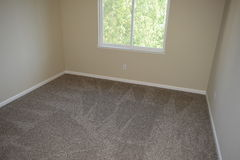 Vacant Room with Professionally Cleaned Carpet. Professional cleaned carpet of a vacant or empty bedroom Stock Image