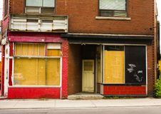 Vacant Store Front in Toronto. Vacant store-front with boarded up windows in Toronto Royalty Free Stock Images