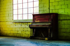 Vacant warehouse window and piano Stock Photography