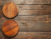 Vacant wooden pizza plates free space vertical Stock Photos