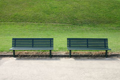 Vacants Seats. Two park seats taken at the seaside stock photography