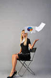 Vacation. Businesswomen on chair throwing documents Royalty Free Stock Photos