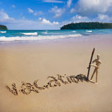 Vacation. A wooden dummy wrote a word vacation on the sand at Patong Beach, Phuket, Thailand Royalty Free Stock Images