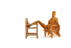Vacation. Laid back vacation style in a wooden chair Royalty Free Stock Photos