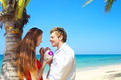 On vacation. A portrait of attractive couple having date on the beach Stock Photography