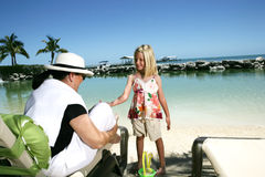 On Vacation. A woman and a little girl enjoying their vacation on the beach Royalty Free Stock Images