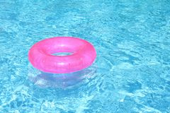 Vacation. Rubber ring floating in pool Royalty Free Stock Images