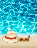 Vacation background with blue sea, a hat and sunglasses. Royalty Free Stock Photo