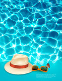 Vacation background with blue sea, a hat and sunglasses. Royalty Free Stock Images