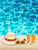 Vacation background with blue sea, a hat and sunglasses. Stock Photo