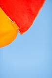Vacation background. Blue sky and beach umbrella Royalty Free Stock Photography