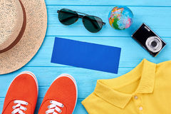 Vacation background, blue wooden board. Colored youth clothing for summer travel Stock Photo