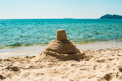 Vacation background with sandcastle Royalty Free Stock Image