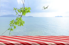 Vacation background at the seaside with picnic table. Stock Photos