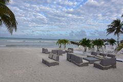 Vacation beach in Aruba for tourists. With couches Royalty Free Stock Photography
