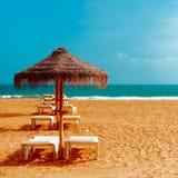 Vacation Beach. Beach chairs umbrellas on the ocean Royalty Free Stock Photo