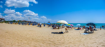 Vacation beach with beachchairs and sunshades on a sunny day Royalty Free Stock Photo