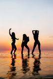 Vacation. Beach Party. Teenage girls having fun in water. Group of happy young people dancing at the on beautiful summer Stock Image