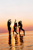 Vacation. Beach Party. Teenage girls having fun in water. Group of happy young people dancing at the on beautiful summer Royalty Free Stock Photo