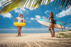 Vacation. Beautiful young fat women and skinny girl on the summer beach stock images