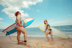 Vacation. Beautiful young fat women and skinny girl on the summer beach stock photography