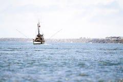 Vacation boat sailing into the horizon stock photos