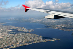 Vacation bound. Aerial view of Florida's gulf coast seen from cabin of passenger plane Royalty Free Stock Images