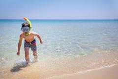 Vacation boy happy snorkeling running having fun in water splashing Royalty Free Stock Photo