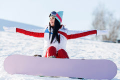 Vacation of brunette with snowboard. In mountains at winter royalty free stock image