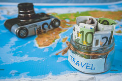 Vacation budget concept. Vacation money savings in a glass jar Royalty Free Stock Images
