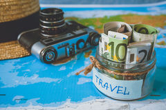 Vacation budget concept. Vacation money savings in a glass jar Royalty Free Stock Photography