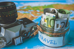 Vacation budget concept. Vacation money savings in a glass jar Royalty Free Stock Image