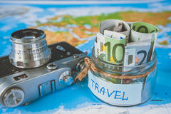 Vacation budget concept. Vacation money savings in a glass jar Stock Image