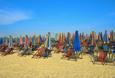 Vacation chairs and umbrellas Stock Photography