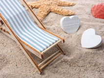 Vacation concept with deckchair and starfish Stock Photo