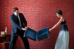 Vacation concept. groom and bride pull suitcase Stock Image