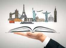 Vacation concept. Hand holding open book with travel sketch. Vacation concept. 3D Rendering Stock Photos