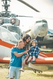 Vacation concept. Happy family enjoy summer vacation at military air show. Child with mother and father sit on plane. Wing during vacation. Family vacation and stock photography