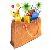 Vacation concept. lady's bag and palm trees with fruit and juice Royalty Free Stock Photography
