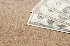 Vacation concept, money on sea sand, travel costs Royalty Free Stock Image