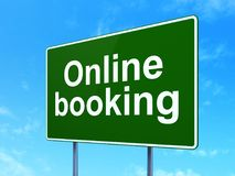 Vacation concept: Online Booking on road sign background. Vacation concept: Online Booking on green road highway sign, clear blue sky background, 3D rendering Stock Photo