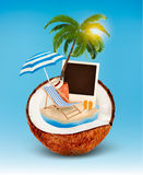Vacation concept. Palm tree, suitcase and a photo in a coconut. Royalty Free Stock Photography