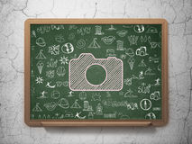 Vacation concept: Photo Camera on School Board Stock Images