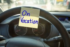 Vacation Concept On Steering Wheel Royalty Free Stock Images