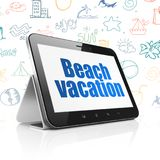 Vacation concept: Tablet Computer with Beach Vacation on display Stock Photography